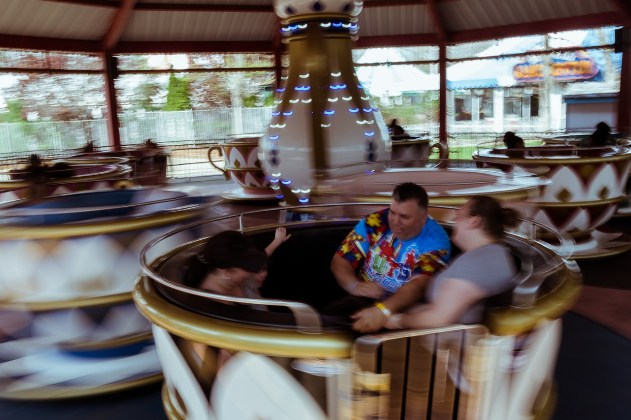 Families whirl around together on the Enchanted Teacups ride, located in the Fantasy Forest area of the park.
